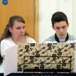 Duet on one piano stool