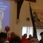 The Boys Brigade colours carried by Jake and received by Terry Lane